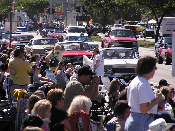 Crowds watch the cars cruise Woodward during the Dream Cruise event.