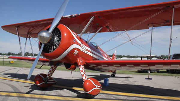 Beautiful red vintage plane waiting for Air Show attendees