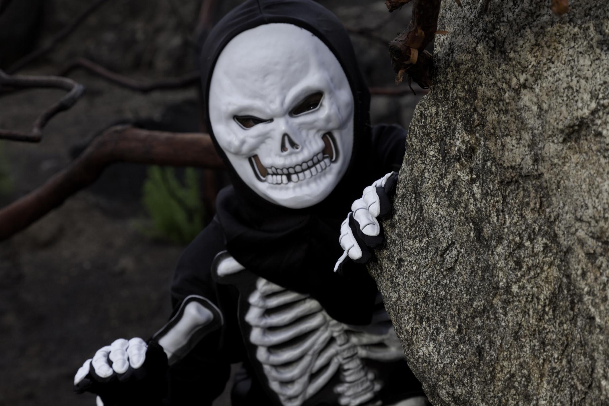 Boy dressed as skeleton.