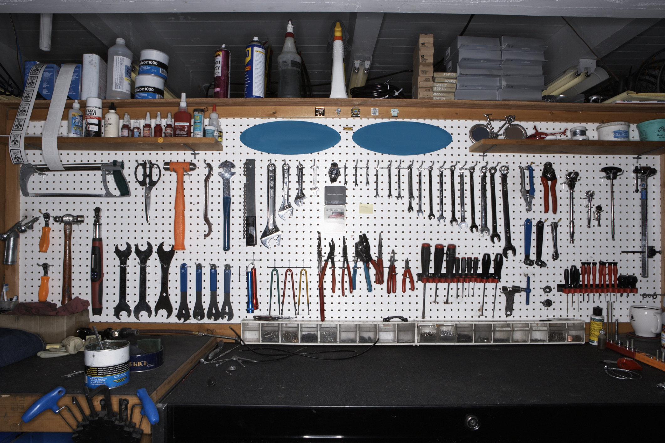 Tools on wall in bicycle shop.