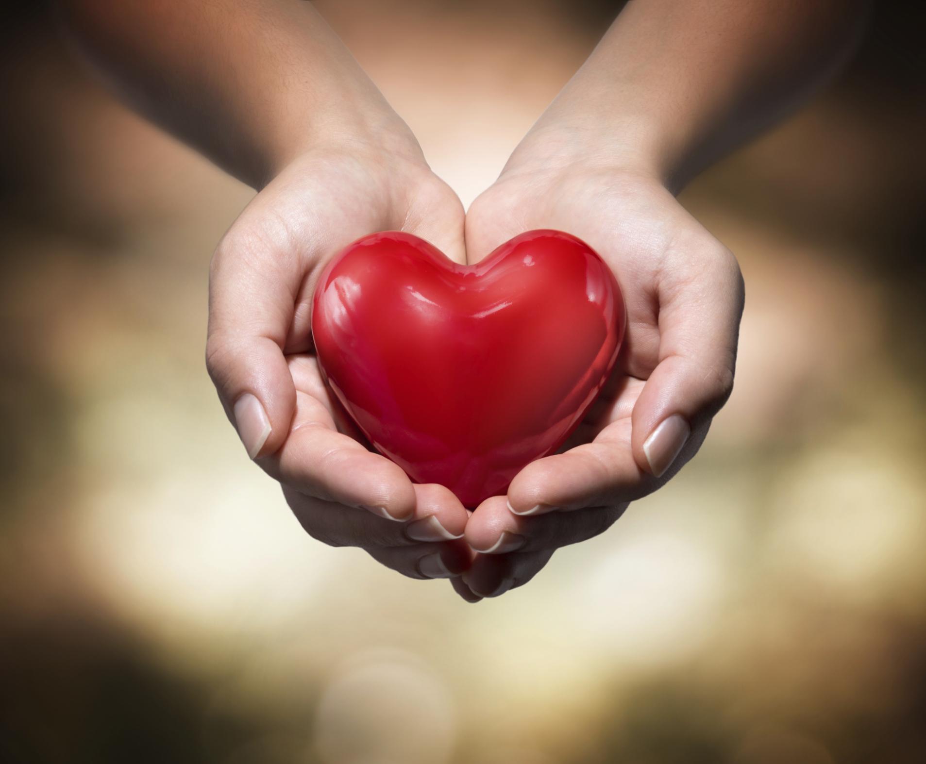 Hand holding a heart bobble.