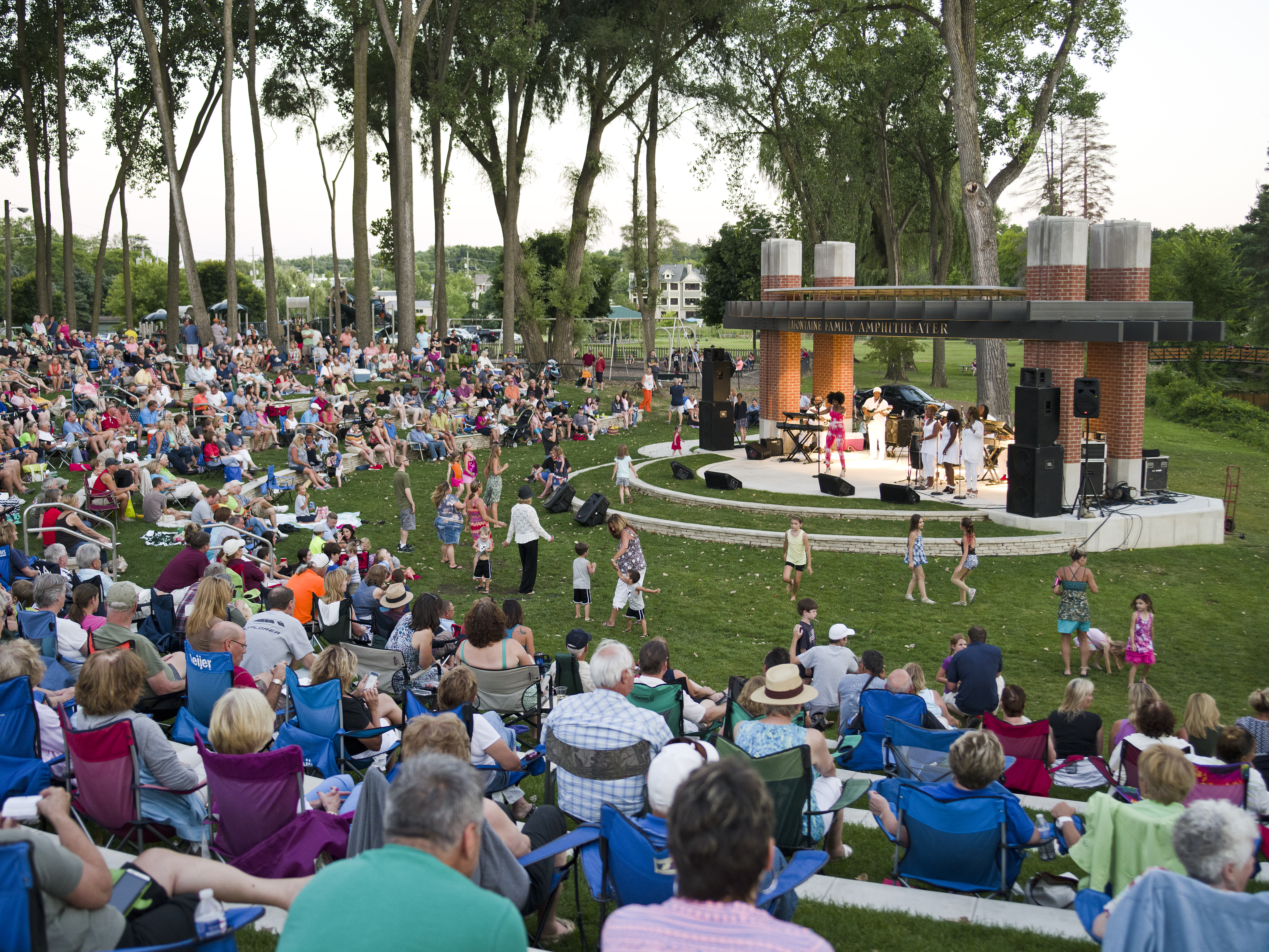Visitors enjoying a concert outside at Milford Amphitheater.