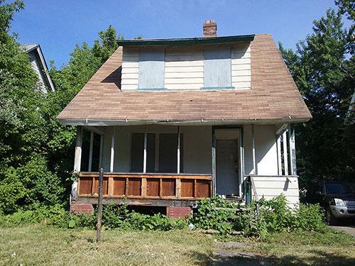 Dilapidated bungalow in Pontiac, Michigan.