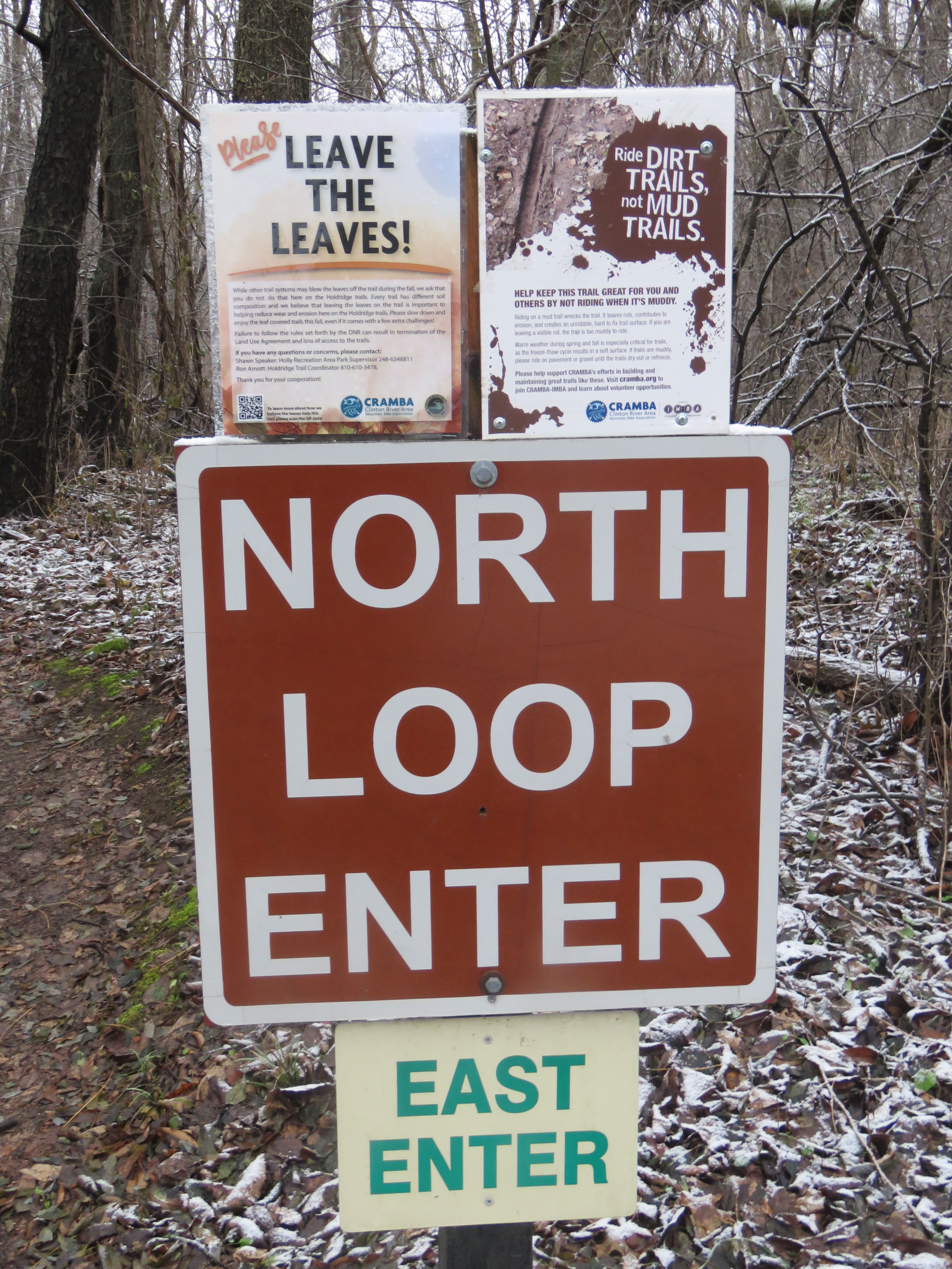 A trail sign that reads: North Loop Enter