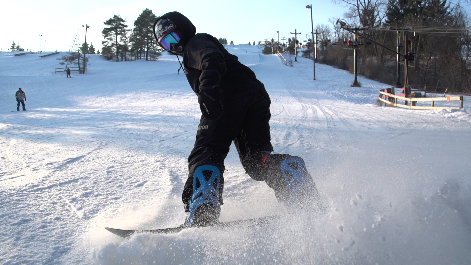 A snowboarder cuts in front of the camera