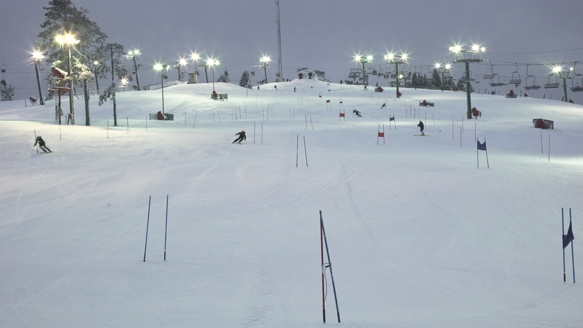Skiers race through the downhill gates portion of Pine Knob.