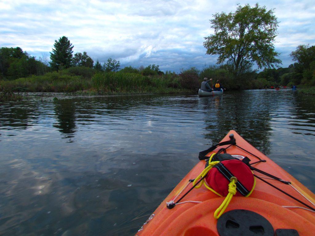 Orange kayak on water