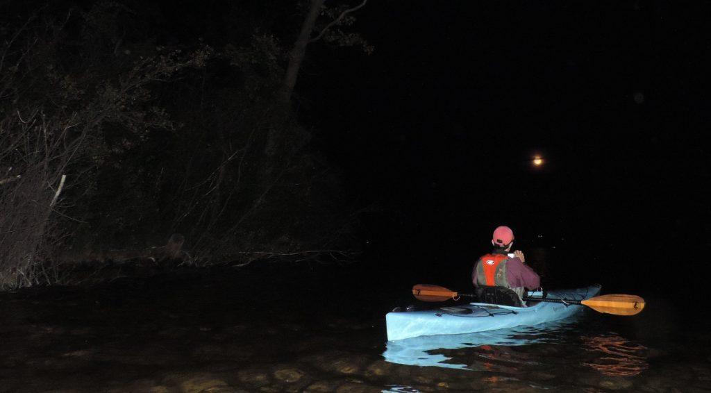 Kayaking in moonlight