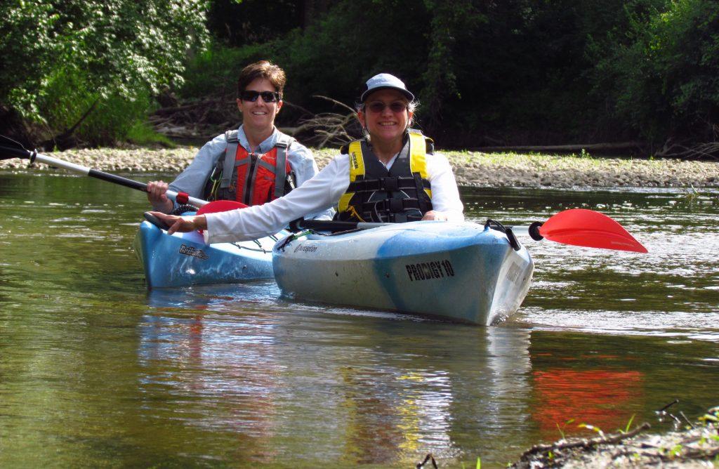 Happy kayakers wearing PFD