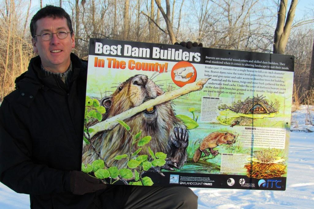 man with beaver habitat signage