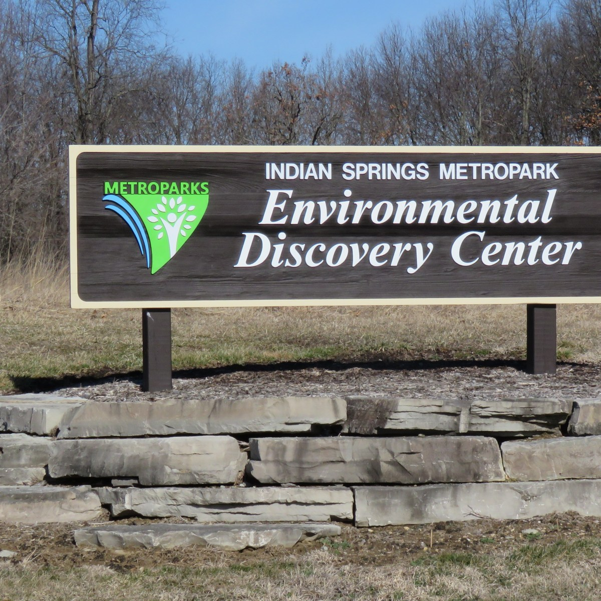 An outdoor sign that reads: Indian Springs Metropark Environmental Discovery Center