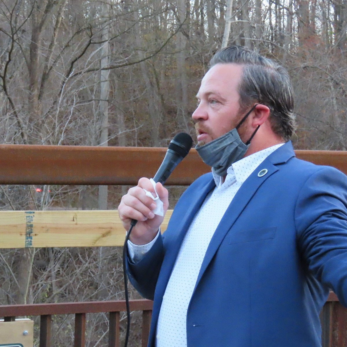 Orion Township Supervisor Chris Barnett speaks into a microphone