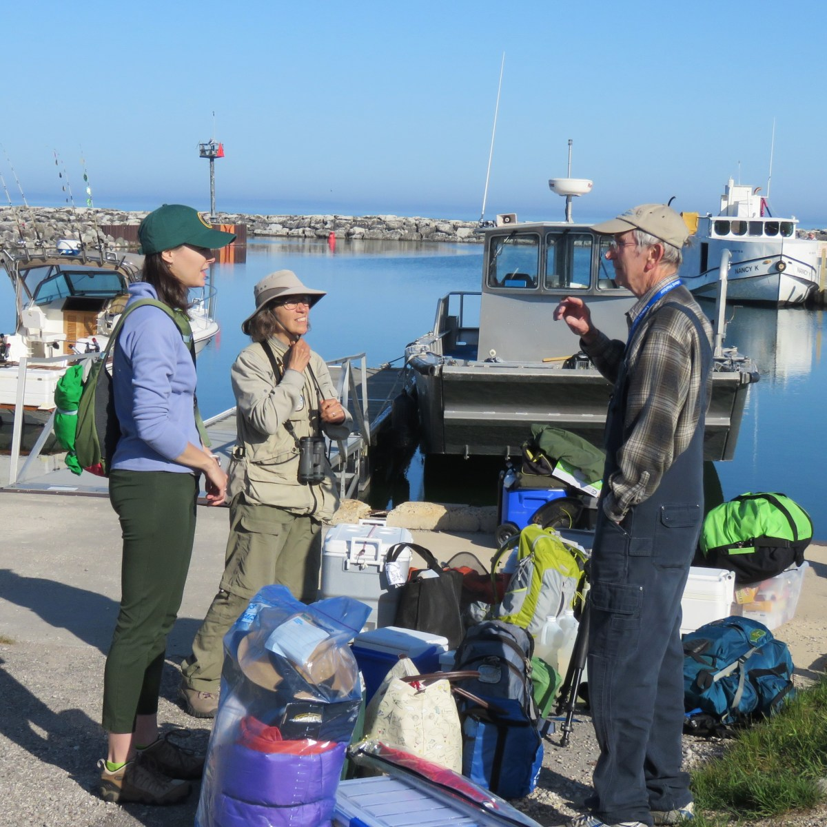 People talking at a fishtown breakwall
